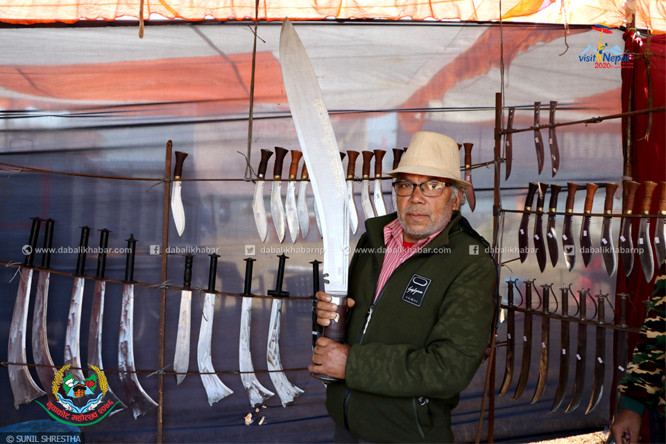 nepal first weighted khukuri showing man in 6th nuwakot mahotsav 2076