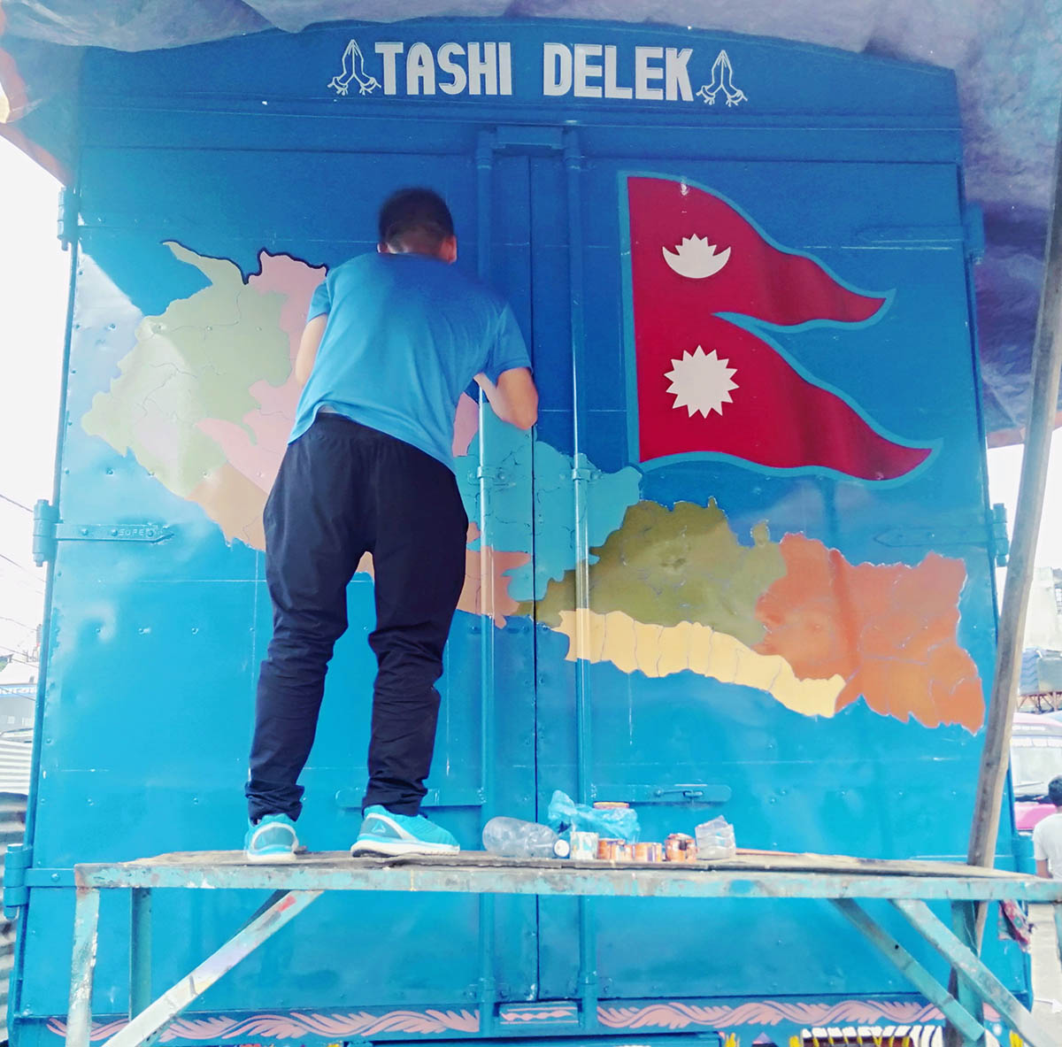 Artist drawing a Nepal new map in container truck