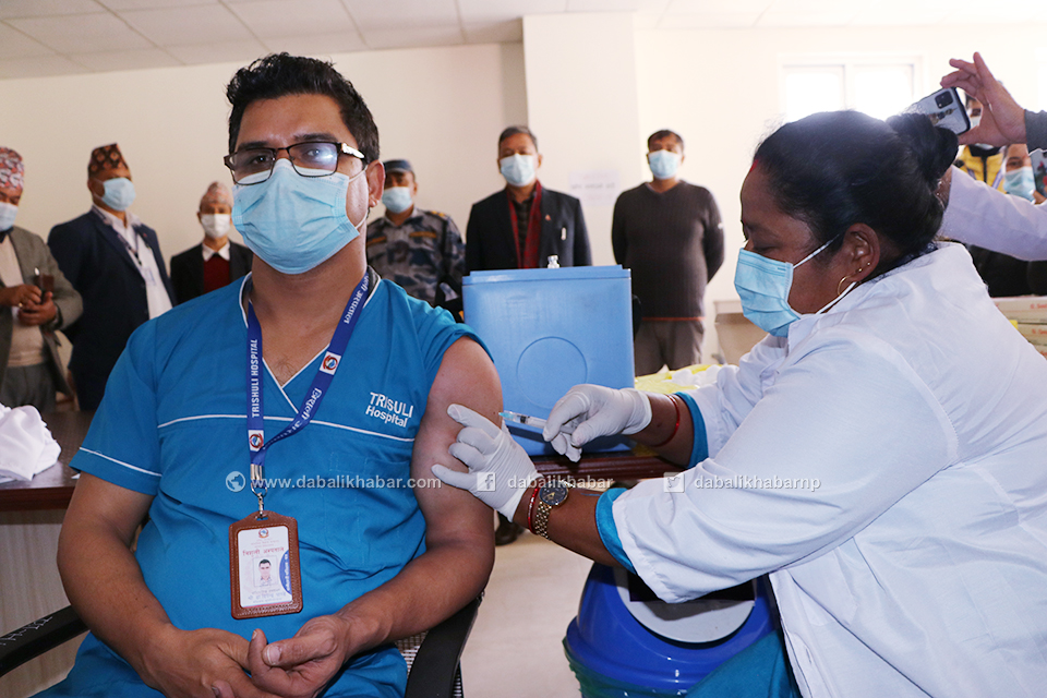 Dr Dipendra Pandey injecting to COVID Shield Vaccine